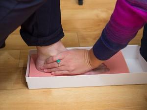 Emily casting feet with biofoam.
