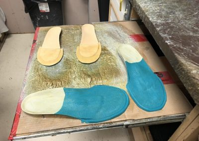 orthotics being assembled
